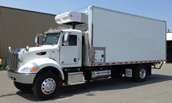 Refrigerated delivery truck with an ATC nose mounted system with optional electric standby. Call 1-833-878-5282 for more info.